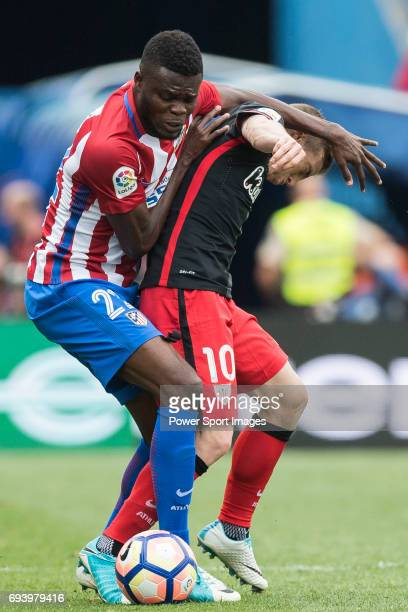 Thomas Teye Partey of Atletico de Madrid fights for the ball with Iker Muniain Goni of Athletic Club during the La Liga match between Atletico de...