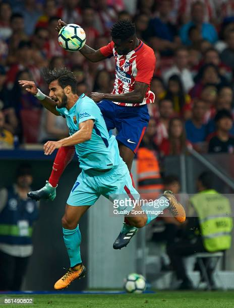 Thomas Teye Partey of Atletico Madrid competes for the ball with Andre Gomes of Barcelona during the La Liga match between Atletico Madrid and...