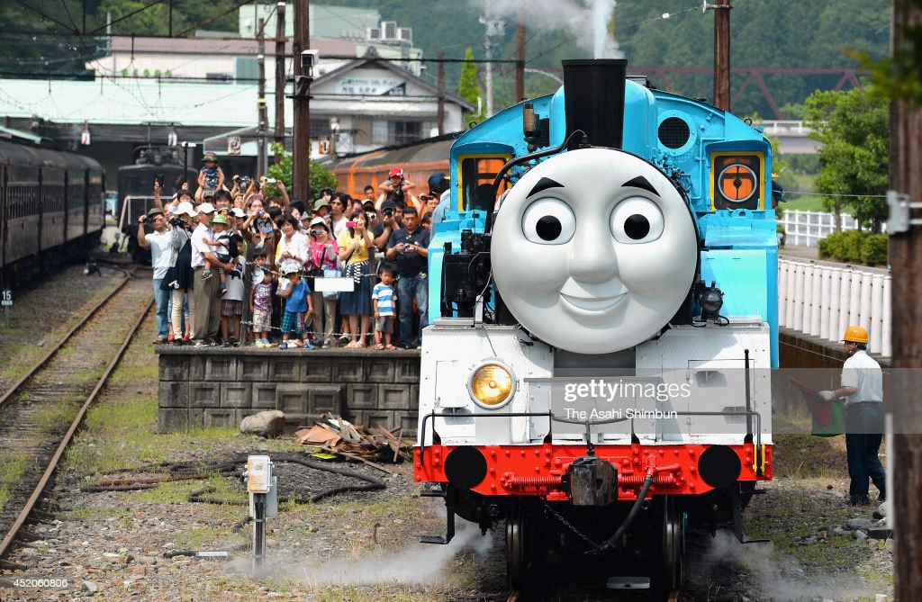 Thomas The Tank Engine departs at Senzu Station on July12, 2014 in Kawanehon, Shizuoka, Japan. The train led by Thomas will operate a total of 52 roundtrips, including two chartered ones, between Shin-Kanaya and Senzu stations on the Oigawa Line until October 12.
