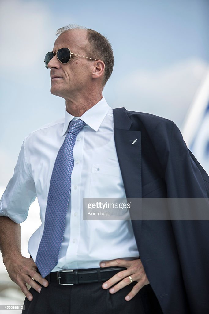 Thomas 'Tom' Enders, chief executive officer of Airbus Group NV, looks on following a successful first flight of the Airbus A320neo aircraft at Toulouse-Blagnac airport in Toulouse, France, on Thursday, Sept. 25, 2014. The Toulouse, France-based manufacturer's long-term forecast predicts demand for almost 9,300 wide-body planes worth $2.5 trillion -- 1,500 of those in the 400-seat-plus bracket occupied by the A380 -- and more than 22,000 single-aisle planes valued at $2.1 trillion in the market dominated by the A320 and Chicago-based Boeing's 737. Photographer: Balint Porneczi/Bloomberg via Getty Images