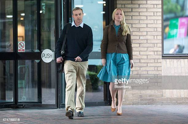 Thomas 'Tom' Hayes a former trader at banks including UBS Group AG and Citigroup Inc left and an unidentified woman leave Southwark Crown Court...