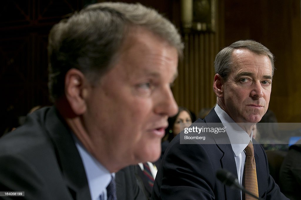 Thomas 'Tom' Horton, chairman, president and chief executive officer of AMR Corp.'s American Airlines, right, looks on as Douglas 'Doug' Parker, chairman and chief executive officer of US Airways Group Inc., speaks during a Senate Judiciary Committee hearing in Washington, D.C., U.S., on Tuesday, March 19, 2013. The proposed merger between American Airlines and US Airways would increase fares, reduce service to smaller communities and make it more difficult for low-cost carriers to compete, two consumer advocates said at a Senate hearing. Photographer: Andrew Harrer/Bloomberg via Getty Images