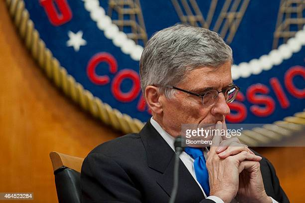 Thomas 'Tom' Wheeler chairman of the Federal Communications Commission listens during an open meeting to vote on internet regulations in Washington...
