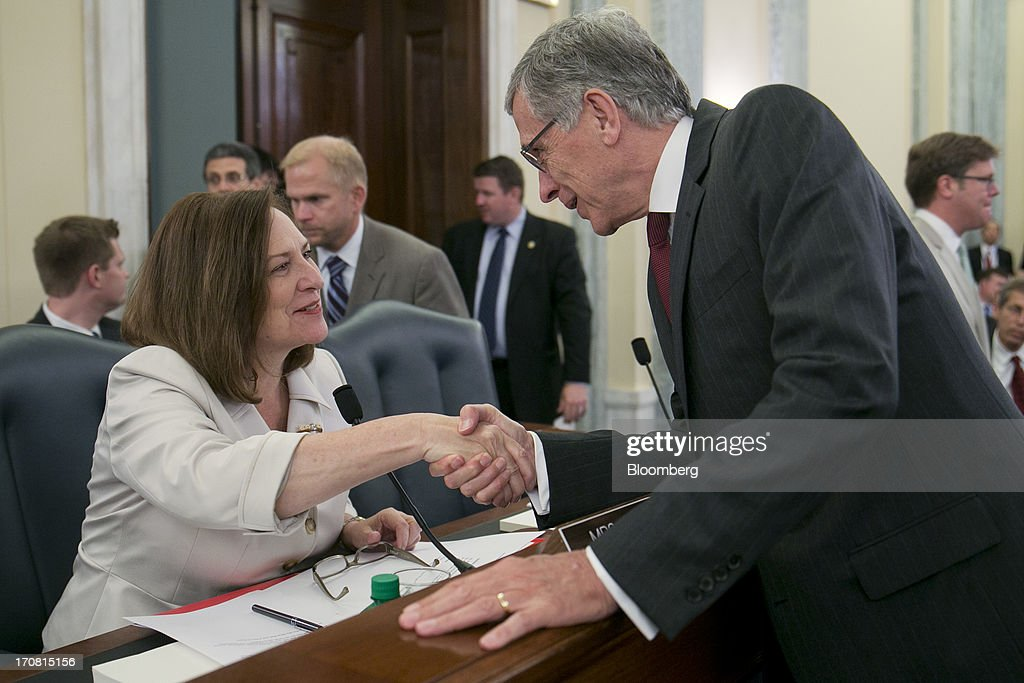 Thomas 'Tom' Wheeler, president and chief executive officer of Shiloh Group LLC and U.S. President Barack Obama's nominee as chairman of the Federal Communications Commission (FCC), right, shakes hands with Representative Debra 'Deb' Fischer, a Republican from Nebraska, before the start of a Senate Commerce, Science, and Transportation nomination hearing in Washington, D.C., U.S., on Tuesday, June 18, 2013. On May 1 President Obama named Wheeler, a venture capitalist and former communications industry lobbyist, to succeed Julius Genachowski as chairman of the FCC. Photographer: Andrew Harrer/Bloomberg via Getty Images