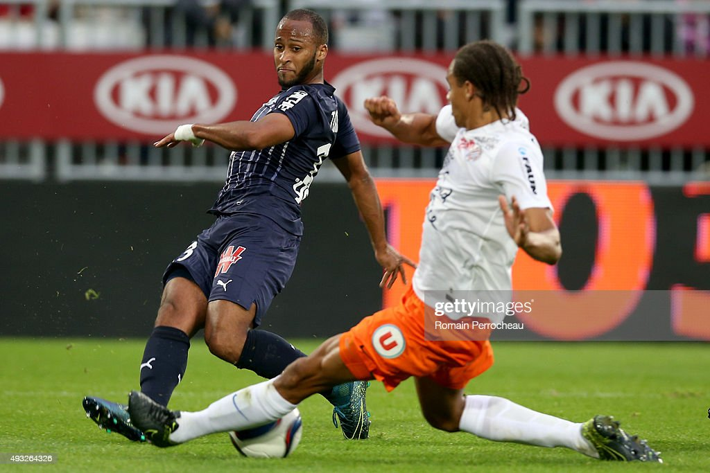 Thomas Toure for FC Girondins de Bordeaux is tackled by <a gi-track='captionPersonalityLinkClicked' href=/galleries/search?phrase=Daniel+Congre&family=editorial&specificpeople=2167788 ng-click='$event.stopPropagation()'>Daniel Congre</a> for Montpellier Herault SC during the French Ligue 1 game between FC Girondins de Bordeaux and Montpellier Herault SC at Stade Matmut Atlantique on October 18, 2015 in Bordeaux, France.