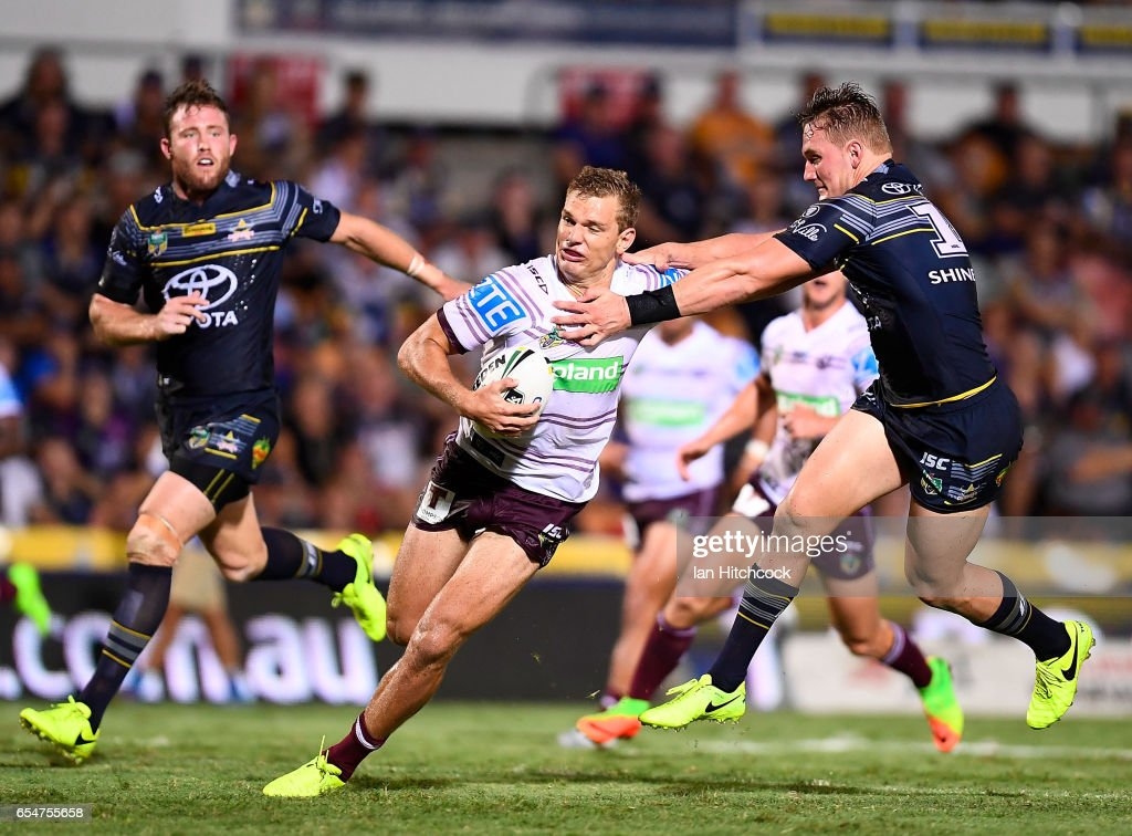 Thomas Trbojevic of the Sea Eagles is tackled by Coen Hess of the Cowboys during the round three NRL match between the North Queensland Cowboys and the Manly Sea Eagles at 1300SMILES Stadium on March 18, 2017 in Townsville, Australia.