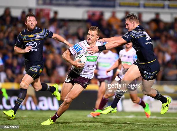 Thomas Trbojevic of the Sea Eagles is tackled by Coen Hess of the Cowboys during the round three NRL match between the North Queensland Cowboys and...