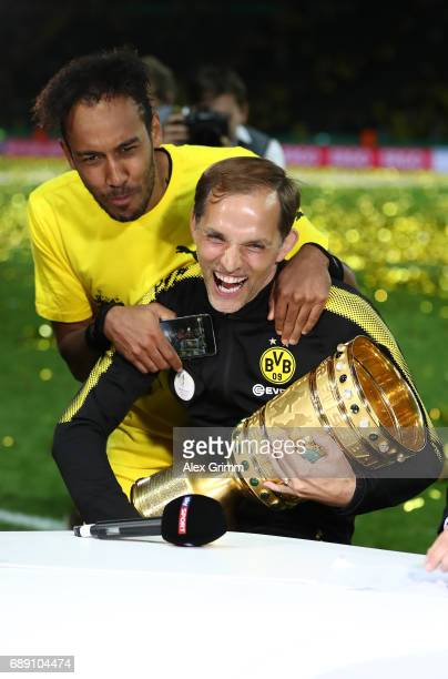 Thomas Tuchel and PierreEmerick Aubameyang of Dortmund joke after winning the DFB Cup final match between Eintracht Frankfurt and Borussia Dortmund...
