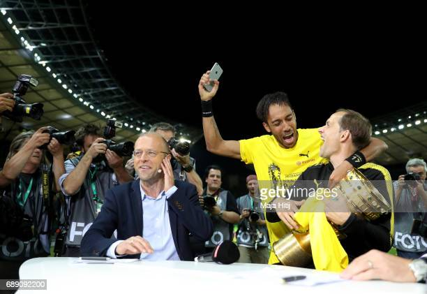 Thomas Tuchel and PierreEmerick Aubameyang of Dortmund joke during an interview after winning the DFB Cup final match between Eintracht Frankfurt and...