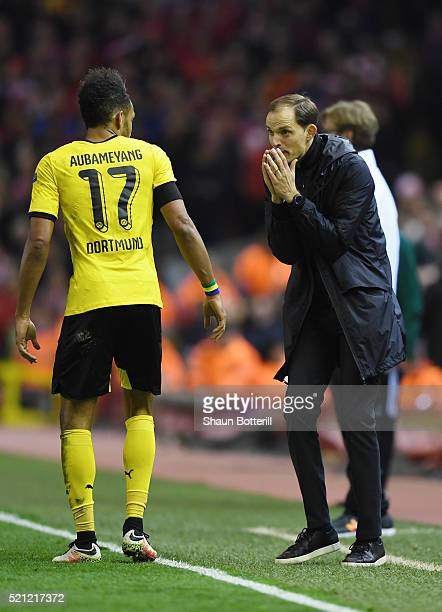 Thomas Tuchel coach of Borussia Dortmund peaks with PierreEmerick Aubameyang of Borussia Dortmund during the UEFA Europa League quarter final second...