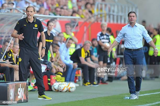 Thomas Tuchel head coach and Michael Zorc manager of Borussia Dortmund react during the Bundesliga match between FC Ingolstadt and Borussia Dortmund...