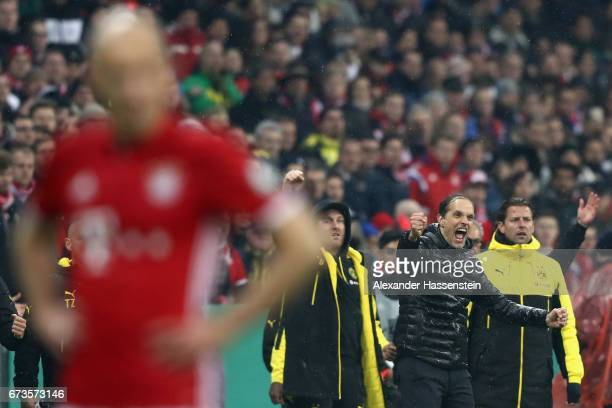Thomas Tuchel head coach of Dortmund celebrates after winning the DFB Cup semi final match between FC Bayern Muenchen and Borussia Dortmund at...