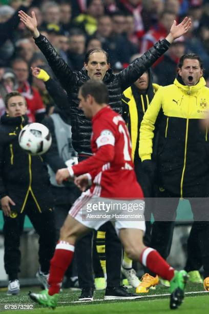 Thomas Tuchel head coach of Dortmund celebrates next to Philipp Lahm of Munich after winning the DFB Cup semi final match between FC Bayern Muenchen...