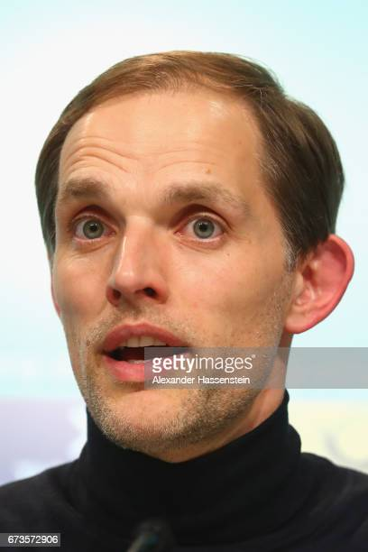 Thomas Tuchel head coach of Dortmund looks on during a press conference after the DFB Cup semi final match between FC Bayern Muenchen and Borussia...