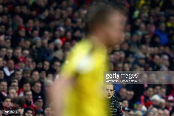 Thomas Tuchel head coach of Dortmund looks on during the DFB Cup semi final match between FC Bayern Muenchen and Borussia Dortmund at Allianz Arena...