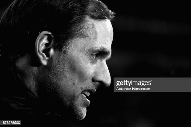 Thomas Tuchel head coach of Dortmund looks on from the team bench prior to the DFB Cup semi final match between FC Bayern Muenchen and Borussia...