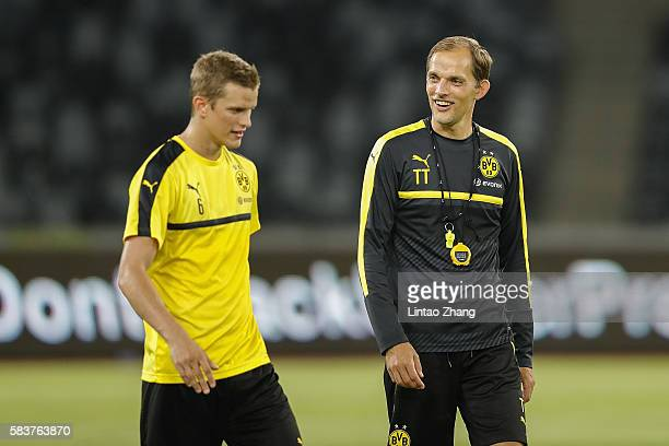 Thomas Tuchel head coach of Dortmund talk with Sven Bender during team training session for 2016 International Champions Cup match between Manchester...