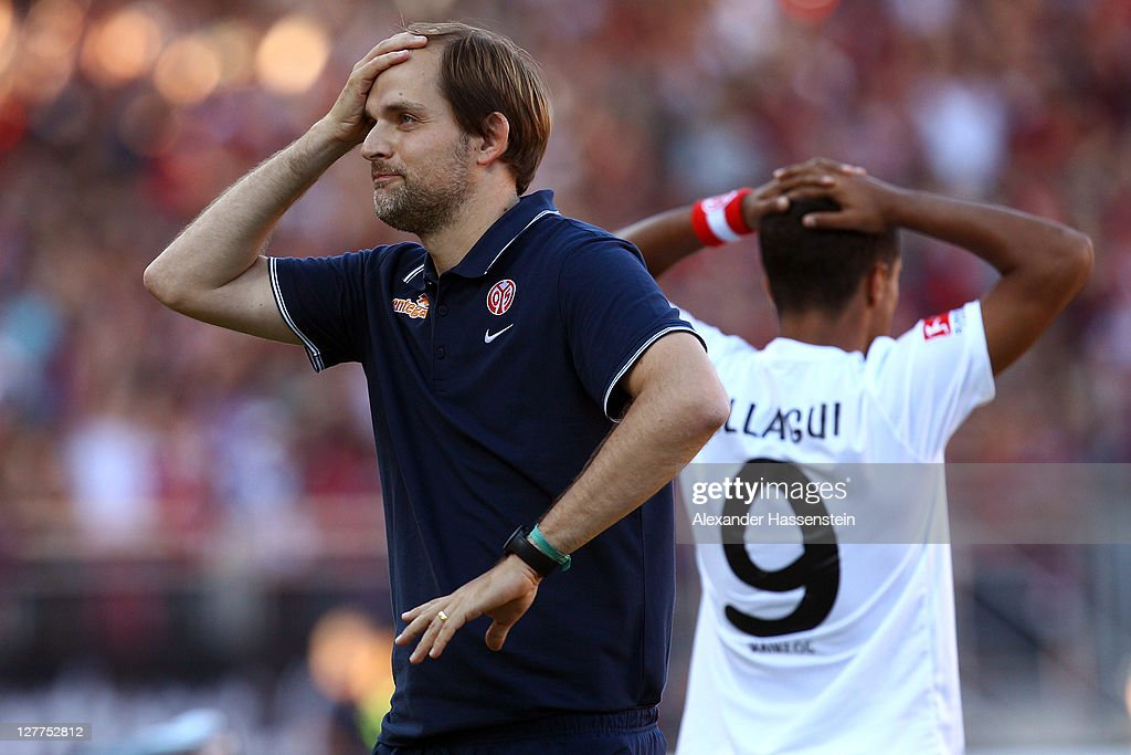 Thomas Tuchel, head coach of Mainz reacts with his player Sami Alagui after receiving the 3rd goal during the Bundesliga match between 1.FC Nuernberg and FSV Mainz 05 at Easy Credit Stadium on October 1, 2011 in Nuremberg, Germany.