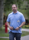 Thomas Tull chairman and chief executive officer of Legendary Entertainment walks to a morning session at the Allen Co Media and Technology...