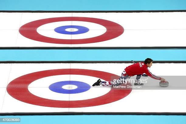 Thomas Ulsrud of Norway throws the rock while playing Great Britain during the Curling at Ice Cube Curling Center on day 11 of the 2014 Sochi Winter...