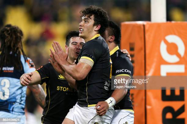Thomas UmagaJensen of Wellington celebrates after scoring a try with Jackson GardenBachop and Asafo Aumua during the Mitre 10 Cup Semi Final match...