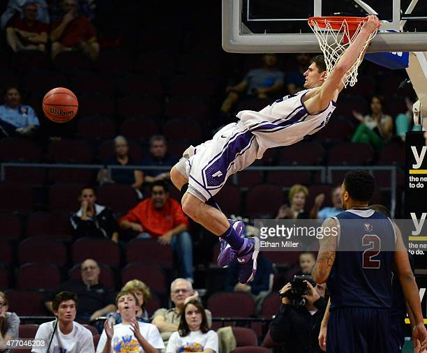 Thomas van der Mars of the Portland Pilots dunks against the Loyola Marymount Lions during an openinground game of the West Coast Conference...