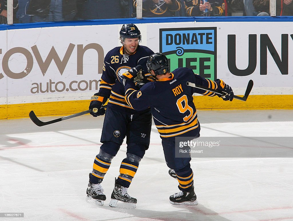 <a gi-track='captionPersonalityLinkClicked' href=/galleries/search?phrase=Thomas+Vanek&family=editorial&specificpeople=570606 ng-click='$event.stopPropagation()'>Thomas Vanek</a> #26 and <a gi-track='captionPersonalityLinkClicked' href=/galleries/search?phrase=Derek+Roy&family=editorial&specificpeople=203272 ng-click='$event.stopPropagation()'>Derek Roy</a> #9 of the Buffalo Sabres celebrate Vanek's second goal of the game against the Toronto Maple Leafs at First Niagara Center on December 16, 2011 in Buffalo, New York.