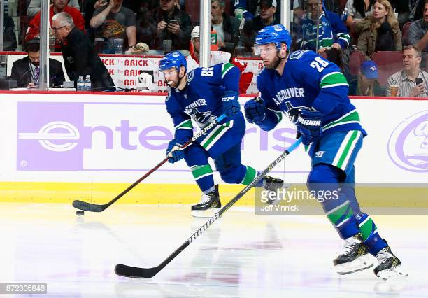 Thomas Vanek and Sam Gagner of the Vancouver Canucks skate up ice during their NHL game against the Detroit Red Wings at Rogers Arena November 6 2017...