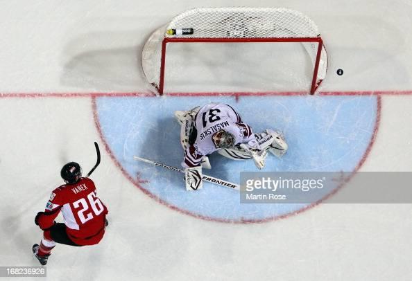 Thomas Vanek of Austria fails to score over Edgars Masalskis goaltender of Latvia during the IIHF World Championship group H match between Austria...