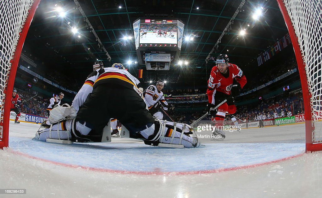 <a gi-track='captionPersonalityLinkClicked' href=/galleries/search?phrase=Thomas+Vanek&family=editorial&specificpeople=570606 ng-click='$event.stopPropagation()'>Thomas Vanek</a> (R) of Austria fails to score over <a gi-track='captionPersonalityLinkClicked' href=/galleries/search?phrase=Rob+Zepp&family=editorial&specificpeople=3121630 ng-click='$event.stopPropagation()'>Rob Zepp</a> (R), goaltender of Germany during the IIHF World Championship group H match between Austria and Germany at Hartwall Areena on May 8, 2013 in Helsinki, Finland.