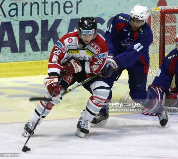 Thomas Vanek of Austria fights for the puck against Pierre Bellemare of France during the Olympia qualifier Austria vs France 11 February 2005 in...