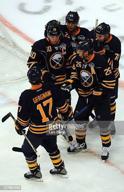 Thomas Vanek of Buffalo celebrates with Christian Ehrhoff and other team mates after scoring a goal during the NHL PreSeason match between Buffalo...