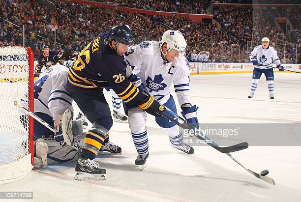 Thomas Vanek of the Buffalo Sabres battles for the puck against Don Phaneuf and James Reimer of the Toronto Maple Leafs at HSBC Arena on February 16...