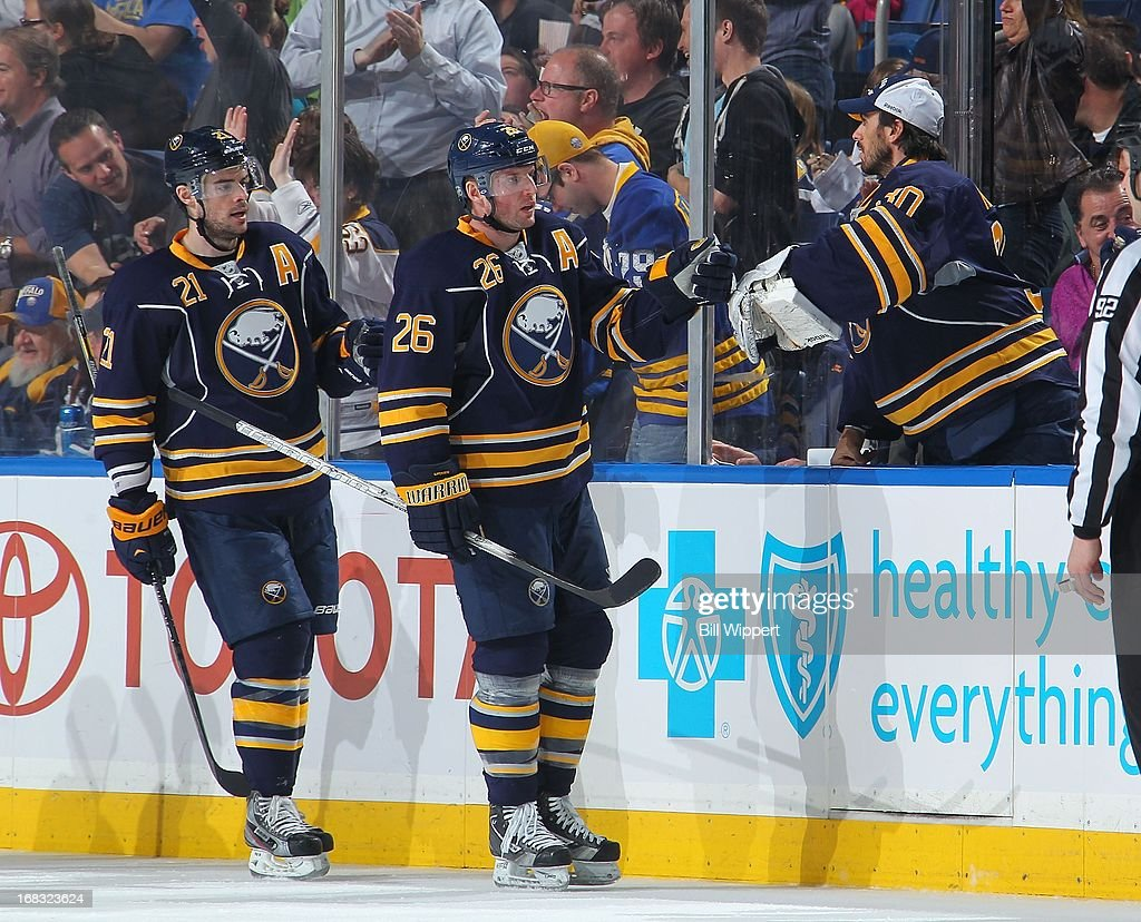 Thomas Vanek #26 of the Buffalo Sabres celebrates a goal against the Winnipeg Jets with teammates Drew Stafford #21 and Ryan Miller #30 on April 22, 2013 at the First Niagara Center in Buffalo, New York.