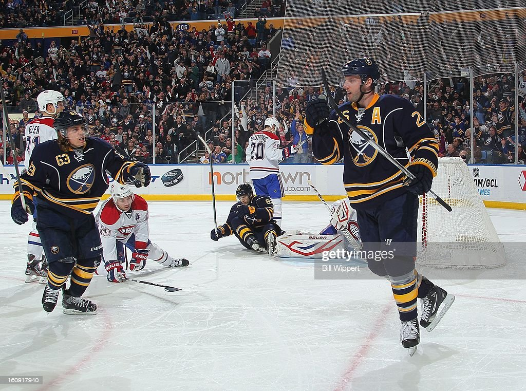 <a gi-track='captionPersonalityLinkClicked' href=/galleries/search?phrase=Thomas+Vanek&family=editorial&specificpeople=570606 ng-click='$event.stopPropagation()'>Thomas Vanek</a> #26 of the Buffalo Sabres celebrates his first goal of the third period with teammate <a gi-track='captionPersonalityLinkClicked' href=/galleries/search?phrase=Tyler+Ennis+-+Ice+Hockey+Player&family=editorial&specificpeople=4754184 ng-click='$event.stopPropagation()'>Tyler Ennis</a> #63 against the Montreal Canadiens on February 7, 2013 at the First Niagara Center in Buffalo, New York. Buffalo defeated Montreal, 4-3, in an overtime shootout.