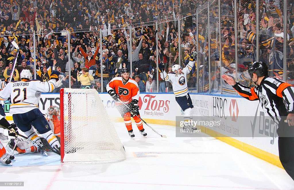 <a gi-track='captionPersonalityLinkClicked' href=/galleries/search?phrase=Thomas+Vanek&family=editorial&specificpeople=570606 ng-click='$event.stopPropagation()'>Thomas Vanek</a> #26 of the Buffalo Sabres celebrates his game winning overtime goal against the Philadelphia Flyers at HSBC Arena on March 8, 2011 in Buffalo, New York, securing the Sabres a spot in the playoffs.