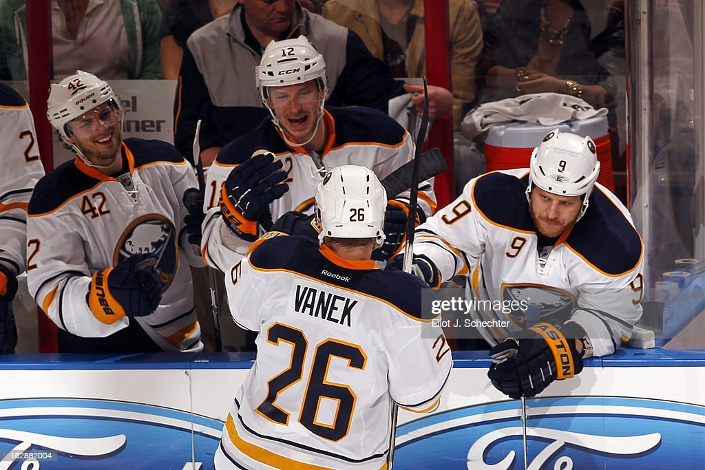 <a gi-track='captionPersonalityLinkClicked' href=/galleries/search?phrase=Thomas+Vanek&family=editorial&specificpeople=570606 ng-click='$event.stopPropagation()'>Thomas Vanek</a> #26 of the Buffalo Sabres celebrates his game winning goal in a shootout with teammates against the Florida Panthers at the BB&T Center on February 28, 2013 in Sunrise, Florida.