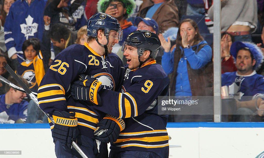 <a gi-track='captionPersonalityLinkClicked' href=/galleries/search?phrase=Thomas+Vanek&family=editorial&specificpeople=570606 ng-click='$event.stopPropagation()'>Thomas Vanek</a> #26 of the Buffalo Sabres celebrates his third period goal with teammate <a gi-track='captionPersonalityLinkClicked' href=/galleries/search?phrase=Derek+Roy&family=editorial&specificpeople=203272 ng-click='$event.stopPropagation()'>Derek Roy</a> #9 in their 5-4 victory over the Toronto Maple Leafs at First Niagara Center on December 16, 2011 in Buffalo, New York.