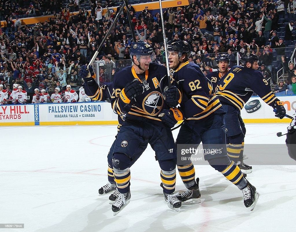 <a gi-track='captionPersonalityLinkClicked' href=/galleries/search?phrase=Thomas+Vanek&family=editorial&specificpeople=570606 ng-click='$event.stopPropagation()'>Thomas Vanek</a> #26 of the Buffalo Sabres celebrates with teammate Marcus Foligno #82 after scoring a goal with 1.9 seconds remaining in the third period to tie the game against the Montreal Canadiens on February 7, 2013 at the First Niagara Center in Buffalo, New York. Buffalo defeated Montreal, 4-3, in an overtime shootout.