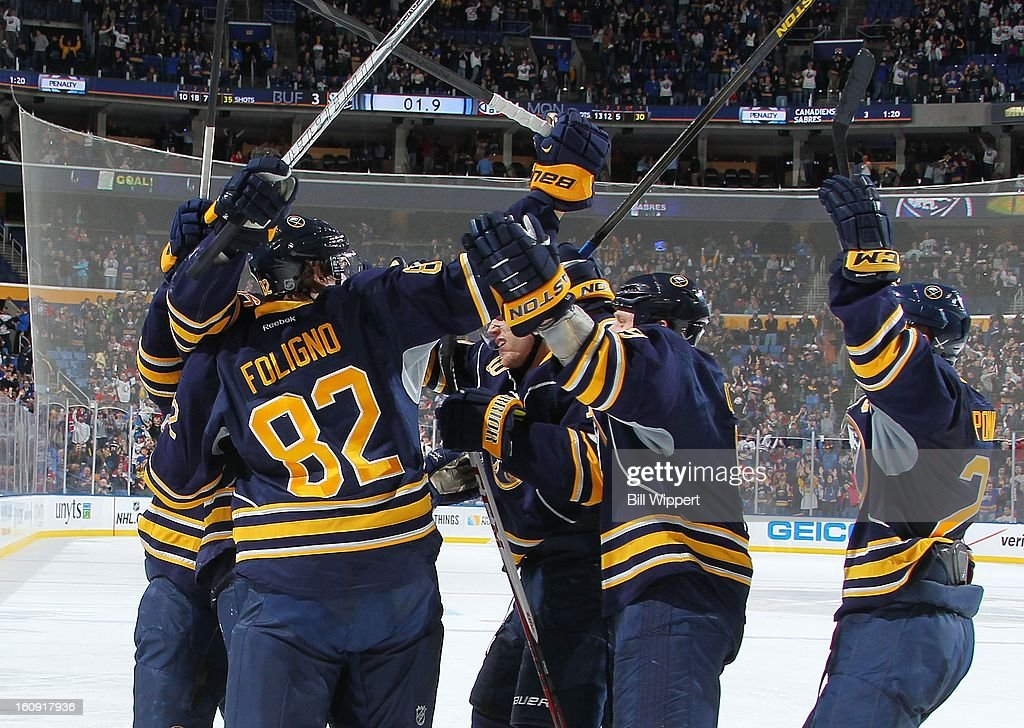 <a gi-track='captionPersonalityLinkClicked' href=/galleries/search?phrase=Thomas+Vanek&family=editorial&specificpeople=570606 ng-click='$event.stopPropagation()'>Thomas Vanek</a> #26 of the Buffalo Sabres celebrates with teammates after scoring a goal with 1.9 seconds remaining in the third period to tie the game against the Montreal Canadiens on February 7, 2013 at the First Niagara Center in Buffalo, New York. Buffalo defeated Montreal, 4-3, in an overtime shootout.
