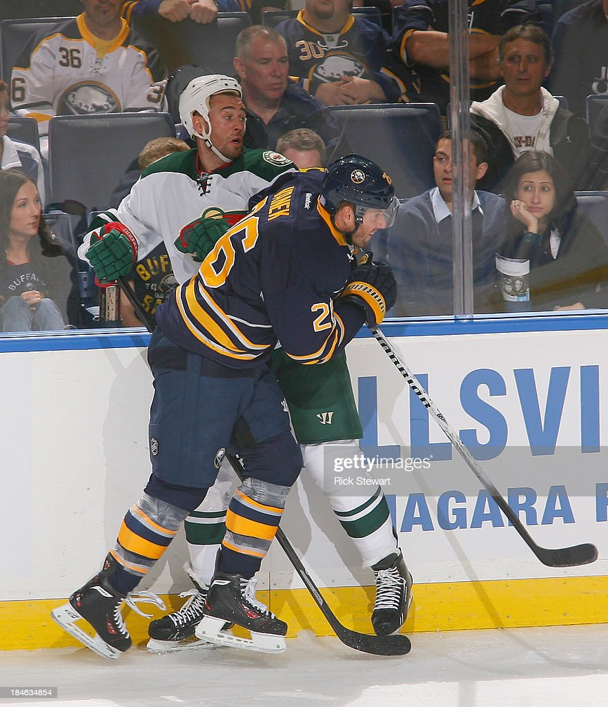 <a gi-track='captionPersonalityLinkClicked' href=/galleries/search?phrase=Thomas+Vanek&family=editorial&specificpeople=570606 ng-click='$event.stopPropagation()'>Thomas Vanek</a> #26 of the Buffalo Sabres checks <a gi-track='captionPersonalityLinkClicked' href=/galleries/search?phrase=Zenon+Konopka&family=editorial&specificpeople=2105876 ng-click='$event.stopPropagation()'>Zenon Konopka</a> #28 of the Minnesota Wild at First Niagara Center on October 14, 2013 in Buffalo, New York.