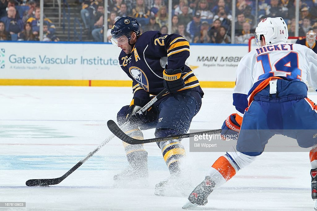 Thomas Vanek #26 of the Buffalo Sabres controls the puck against Thomas Hickey #14 of the New York Islanders on April 26, 2013 at the First Niagara Center in Buffalo, New York.