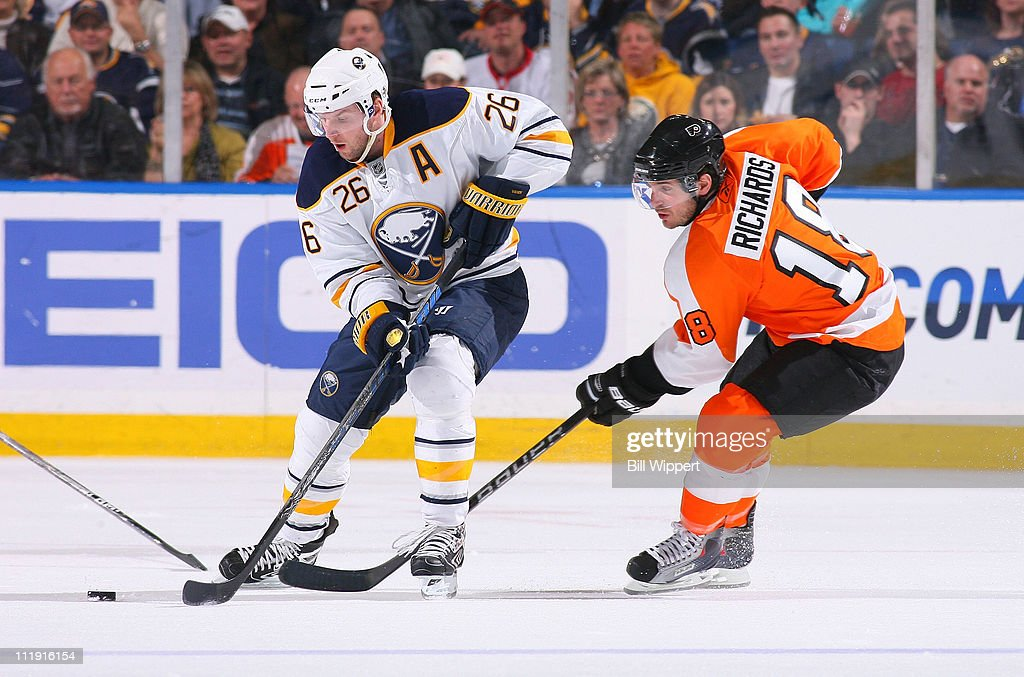 <a gi-track='captionPersonalityLinkClicked' href=/galleries/search?phrase=Thomas+Vanek&family=editorial&specificpeople=570606 ng-click='$event.stopPropagation()'>Thomas Vanek</a> #26 of the Buffalo Sabres controls the puck in front of Mike Richards #18 of the Philadelphia Flyers at HSBC Arena on March 8, 2011 in Buffalo, New York.