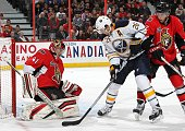 Thomas Vanek of the Buffalo Sabres creates a screen against Craig Anderson and Jared Cowen of the Ottawa Senators as the puck trickles into the net...