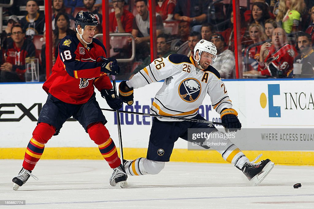 Thomas Vanek #26 of the Buffalo Sabres crosses sticks with Shawn Matthias #18 of the Florida Panthers at the BB&T Center on October 25, 2013 in Sunrise, Florida.