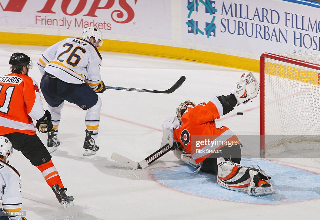 <a gi-track='captionPersonalityLinkClicked' href=/galleries/search?phrase=Thomas+Vanek&family=editorial&specificpeople=570606 ng-click='$event.stopPropagation()'>Thomas Vanek</a> #26 of the Buffalo Sabres gets the puck behind <a gi-track='captionPersonalityLinkClicked' href=/galleries/search?phrase=Sergei+Bobrovsky&family=editorial&specificpeople=4488556 ng-click='$event.stopPropagation()'>Sergei Bobrovsky</a> #35 of the Philadelphia Flyers for the game winning goal in overtime at HSBC Arena on April 8, 2011 in Buffalo, New York. Buffalo won 4-3 in overtime.