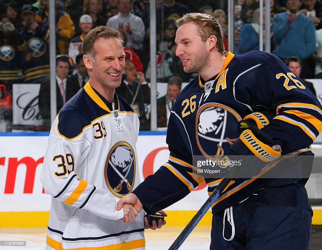 Thomas Vanek of the Buffalo Sabres greets fromer Sabres goaltending great Dominik Hasek before a game against the Atlanta Thrashers at HSBC Arena on...