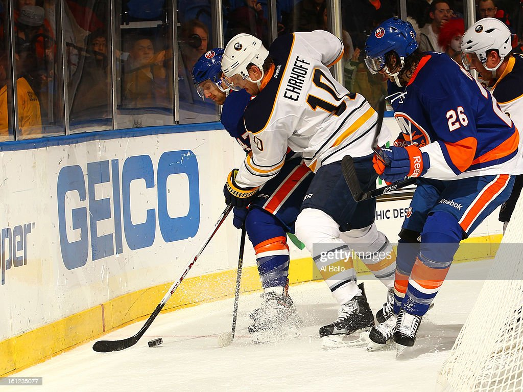 Thomas Vanek #26 of the Buffalo Sabres handles the puck against the New York Islanders during their game at Nassau Veterans Memorial Coliseum on February 9, 2013 in Uniondale, New York.