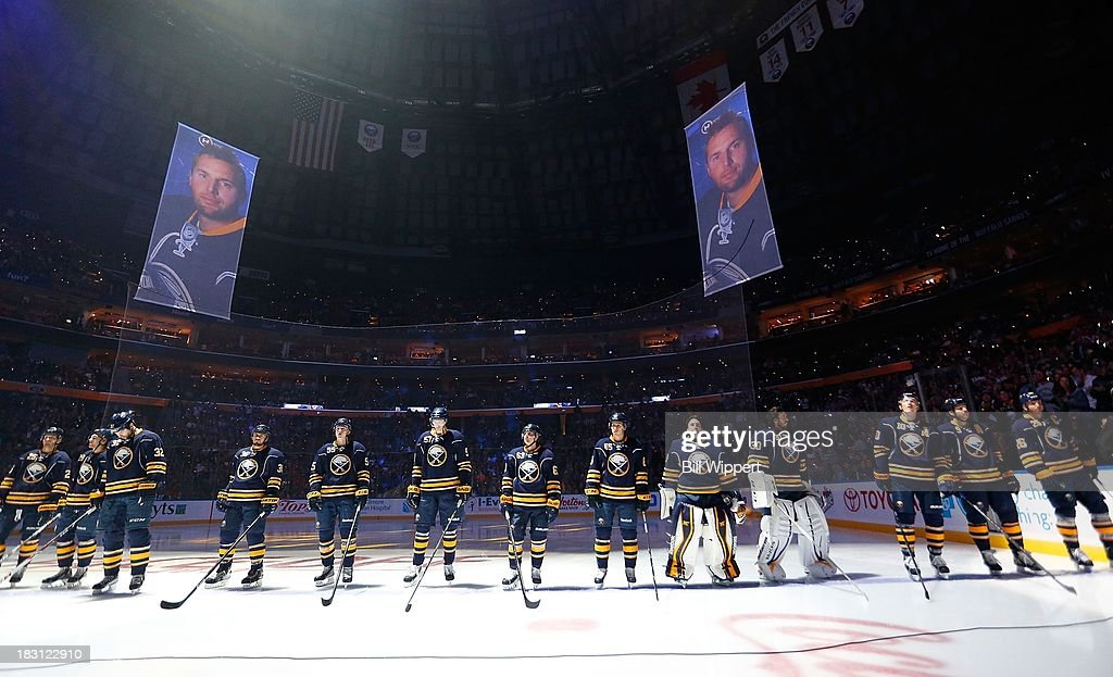 Thomas Vanek #26 of the Buffalo Sabres has his image featured on projection screens during introductions prior to the home opening game against the Ottawa Senators on October 4, 2013 at the First Niagara Center in Buffalo, New York.