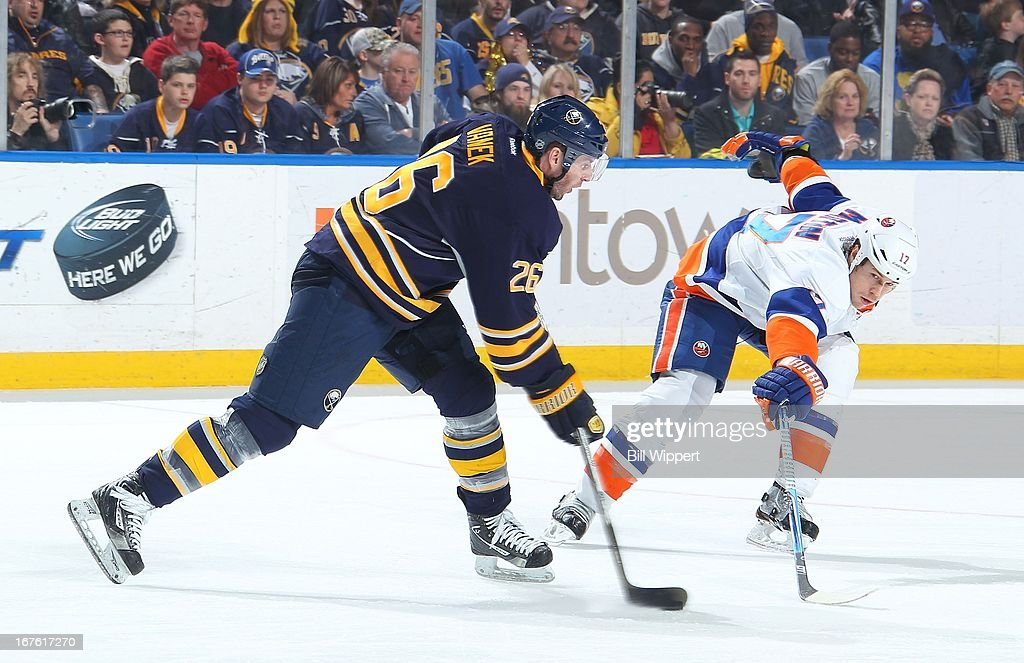 <a gi-track='captionPersonalityLinkClicked' href=/galleries/search?phrase=Thomas+Vanek&family=editorial&specificpeople=570606 ng-click='$event.stopPropagation()'>Thomas Vanek</a> #26 of the Buffalo Sabres has his shot attempt defended by Matt Martin #17 of the New York Islanders on April 26, 2013 at the First Niagara Center in Buffalo, New York.